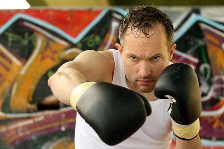 professional boxer doing punching exercises photo
