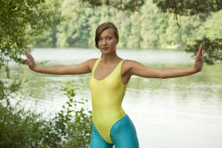 lycra: woman doing fitness exercises in a natural setting
