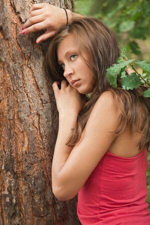 sad young woman posing photo