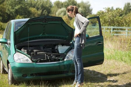 woman with a broken car Stock Photo - 5442475