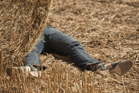 crime scene, woman lying unconscious in the field Stock Photo - 5452650