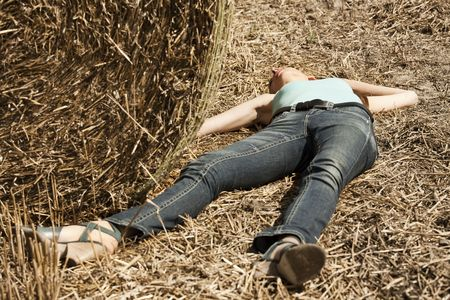 crime scene, young woman playing dead in the field Stock Photo