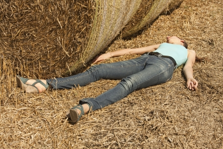 unconscious: woman lying dead in the field