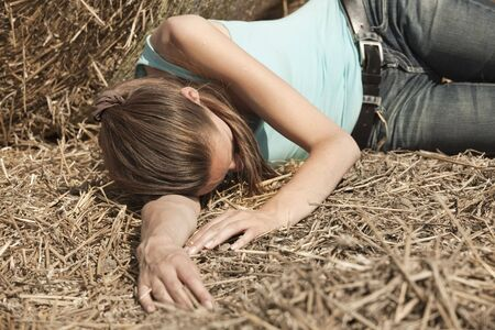 young woman lying unconscious in the field Stock Photo - 5442493