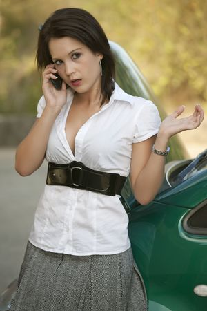 shocked young woman calling car support for a broken car photo