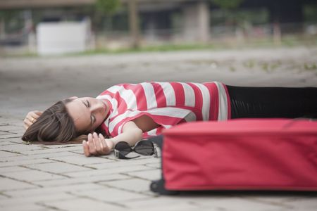 crime scene, unconscious woman lying on asphalt road Stock Photo
