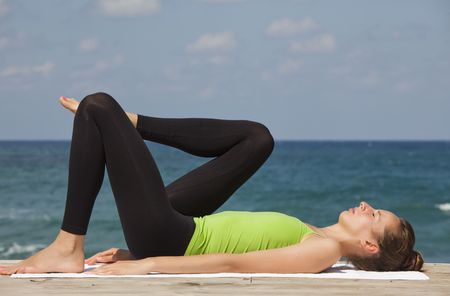 yoga and relaxing exercises at the beach photo