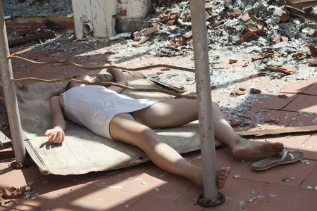 unconscious: model playing a dead woman after terror act on the street