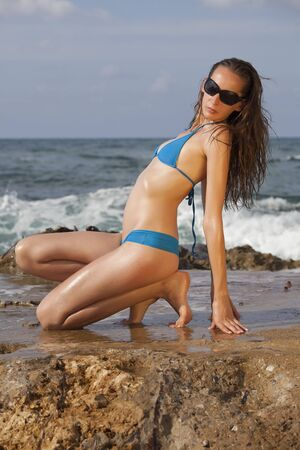 bikini clad woman posing on the beach Stock Photo - 5629743