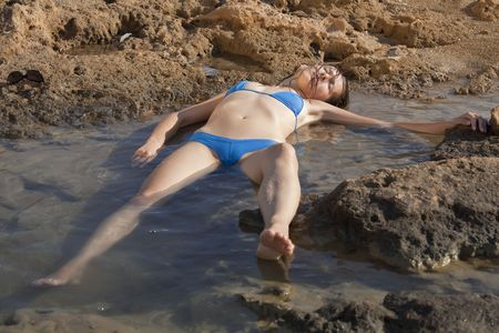 drowning: model playing drowned woman floating in water Stock Photo