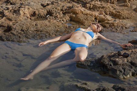 drowning woman in blue bikinis on the beach photo