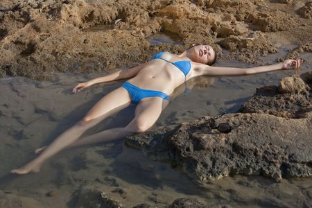 unconscious female model in water playing drowned woman