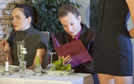surprised man checking the bill in a restaurant photo