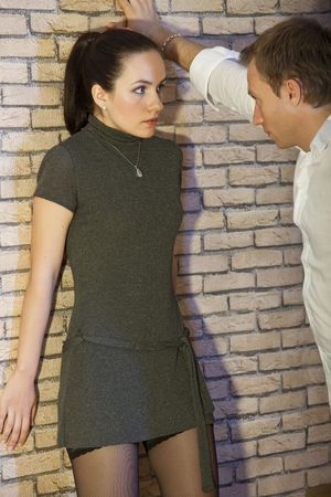 helpless: angry man and helpless woman - conflict situation between couple