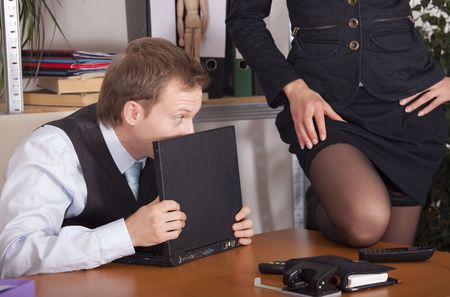 woman flirting with a man by the work photo