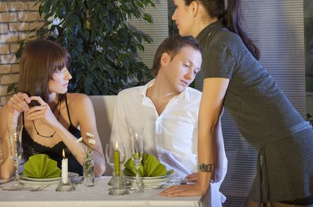 arousing: man flirting with waitress in a restaurant Stock Photo