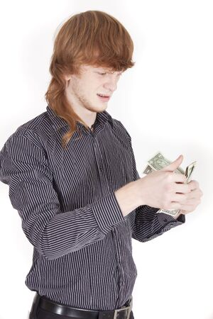 confused man counting money photo