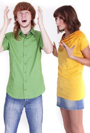 couple fach�: disputer en couple - homme femme en col�re et frustr�s sur blanc Banque d'images