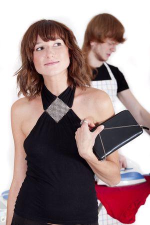 frustrated man ironing - happy woman walking away Stock Photo - 5889175
