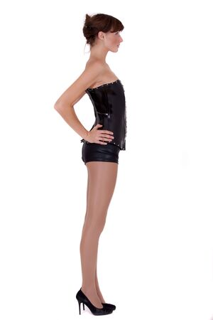 dominatrix woman in leather corsage and shorts photo