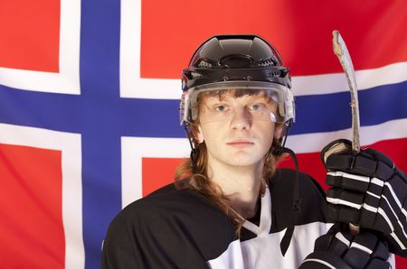 ice hockey player with stick sitting over norwegian flag photo