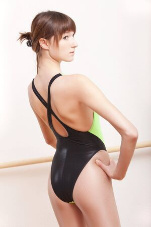 leotard: young female ballet dancer at dancing bar Stock Photo