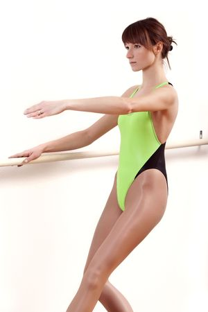 lycra: young female ballet dancer by workout at dancing bar Stock Photo