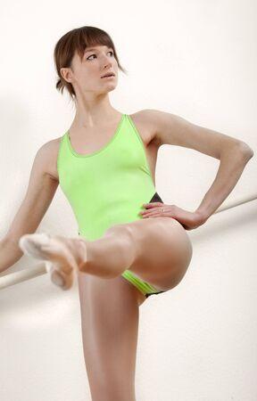 lycra: female ballet dancer working out at dancing bar