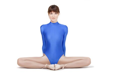 leotard: gymnastic woman stretches on a white background