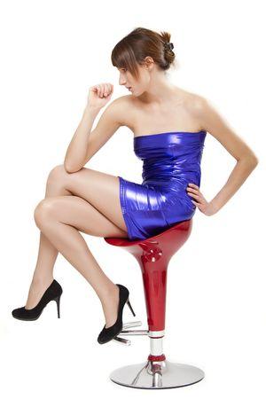 beautiful woman in shiny blue dress sitting on the stool Stock Photo - 6309092