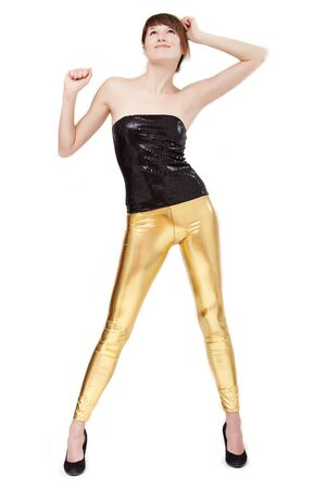 woman in shiny leggings dancing - isolated on white Stock Photo - 6309116