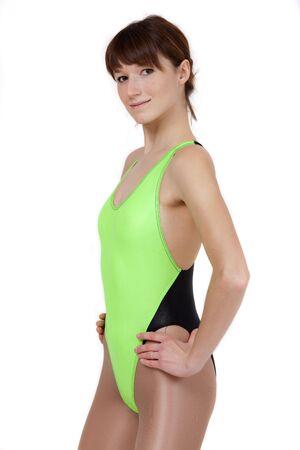 portrait of female gymnast in green leotard photo