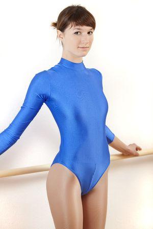 lycra: female ballet dancer in blue leotard at dancing bar Stock Photo
