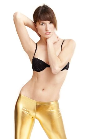 portrait of sensual woman in gold leggings photo