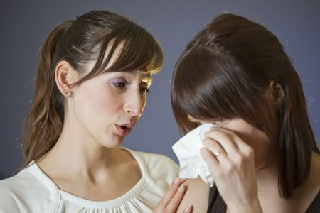 handkerchief: one woman crying with handkerchief - another comforting her