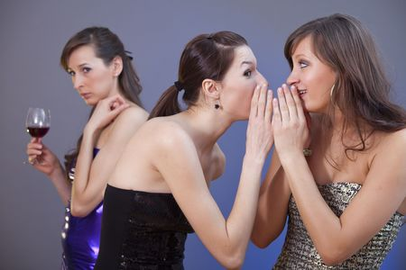 tattle: two women whispering about the other one - shot in studio