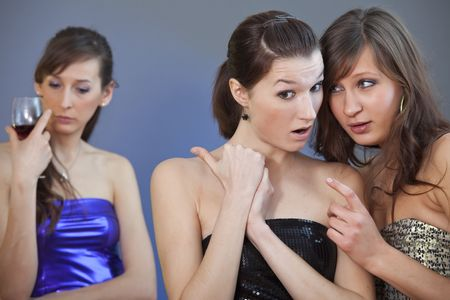 tattle: two girls gossip about other one on the party
