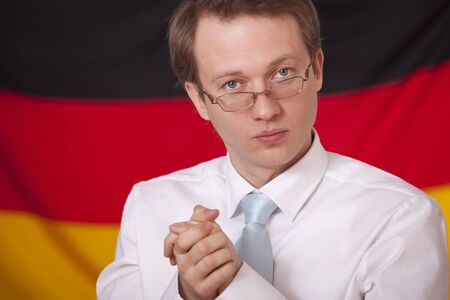 economic cohesion - businessman in front of a german flag photo