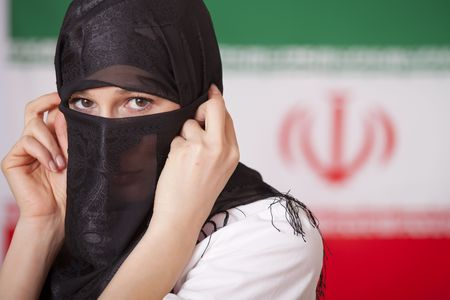 muslim woman in front of iran flag photo