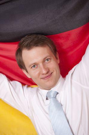 fanatic: happy fanatic businessman with a german flag