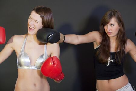 women fight: Two young ladies in a boxing competition Stock Photo