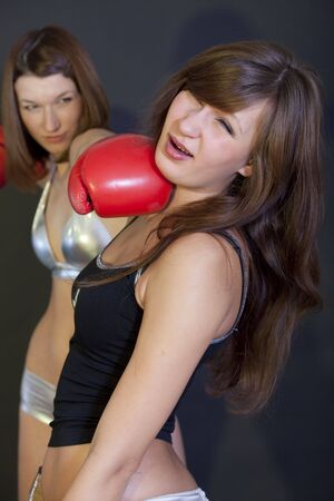 two young women in a boxing competition photo