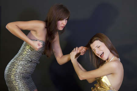 young women fighting on a black background photo