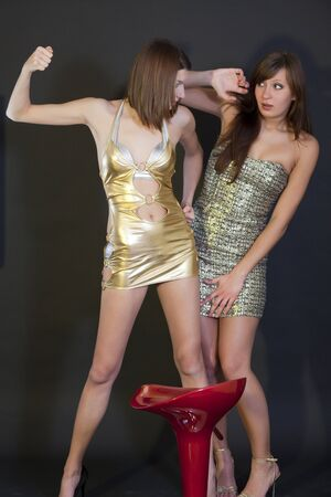 two young women in mini dresses fighting Stock Photo - 6788902