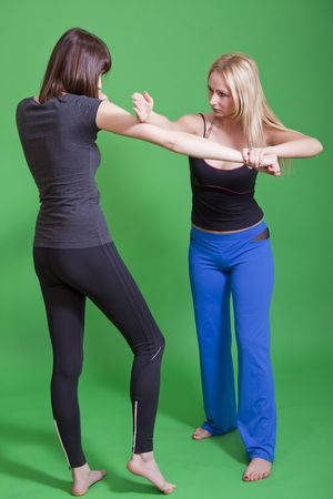 women self defence classes on green background Stock Photo - 6788907