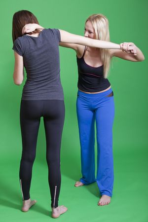 women self defence classes - exercises on green background photo
