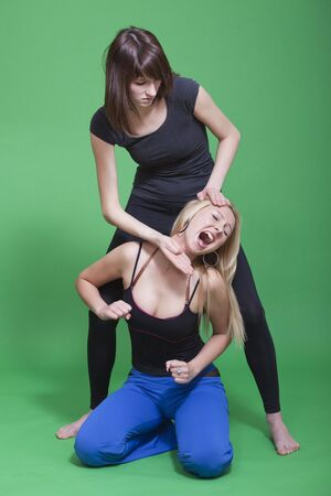 defenceless: two young women fighting - self defence technique  Stock Photo