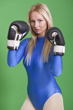 female fighter: portrait of female boxer in blue leotard Stock Photo