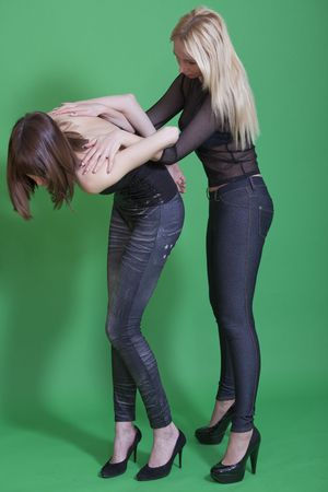 two women in leggings fighting on green background Stock Photo - 6788920