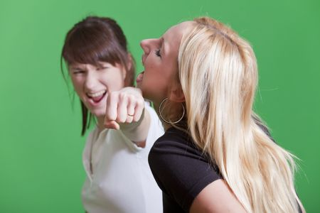 jealousy: young woman punches another girl to the face